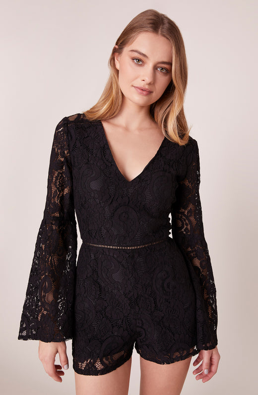 Model wearing black lace romper