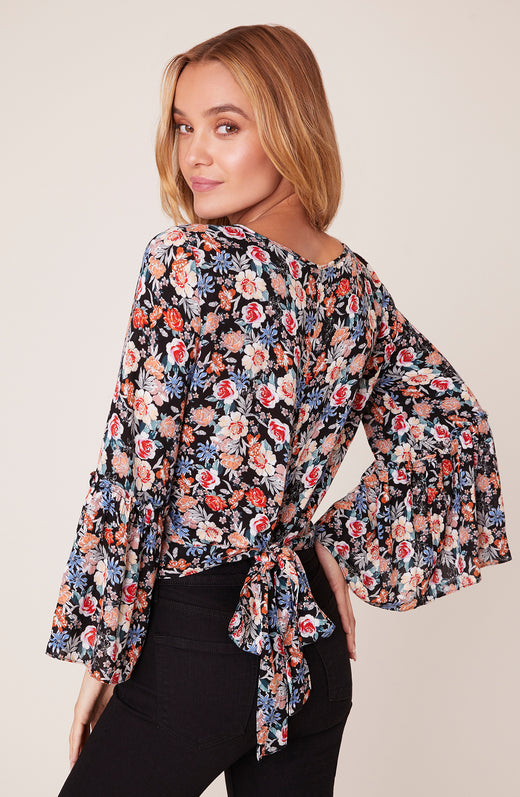 Back view of model wearing long sleeve floral top