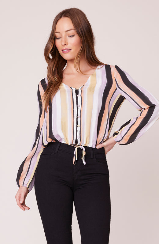 Model wearing vertical stripe blouse