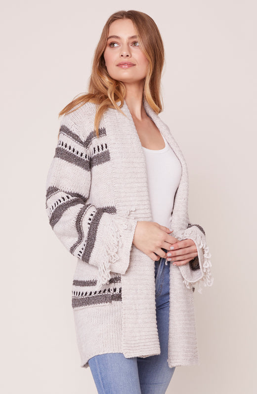 Model wearing striped, draped cardigan