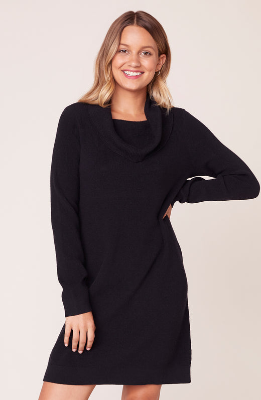 Model wearing black sweater dress