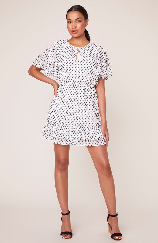 model wearing polka dot printed dress