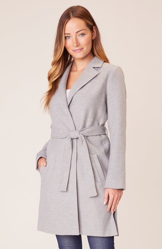Model wearing grey trench coat