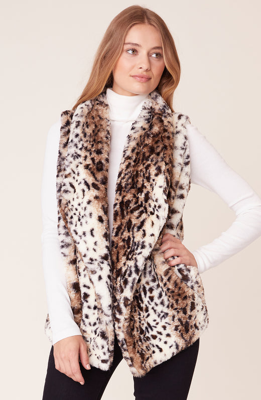 Front view of model wearing leopard printed vest