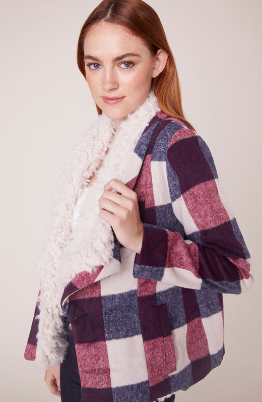 Model wearing plaid sherpa jacket
