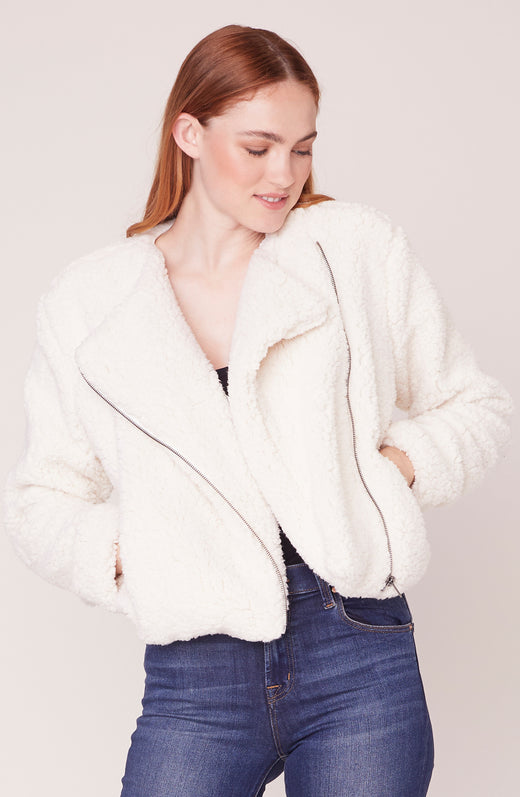 Model wearing white sherpa jacket