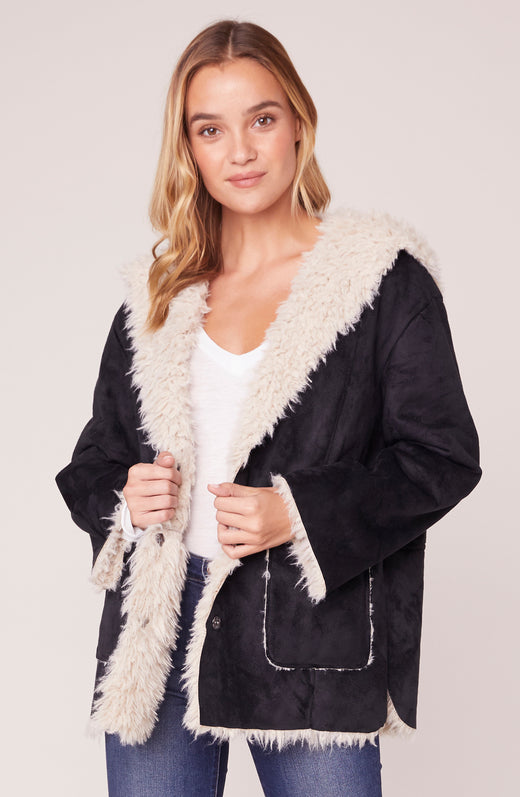 Model wearing black and white sherpa jacket