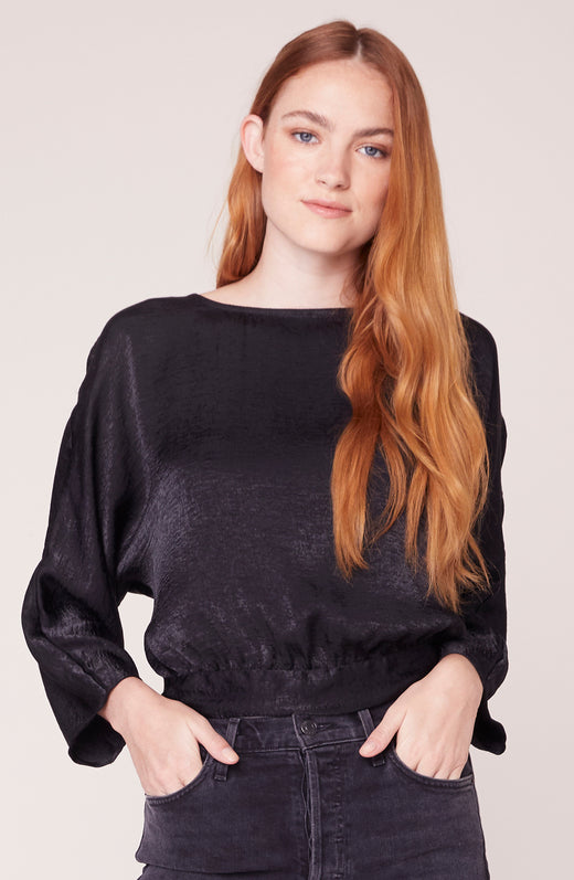 Model wearing long sleeve black top