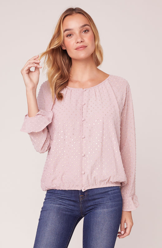 Model wearing pink long sleeve top