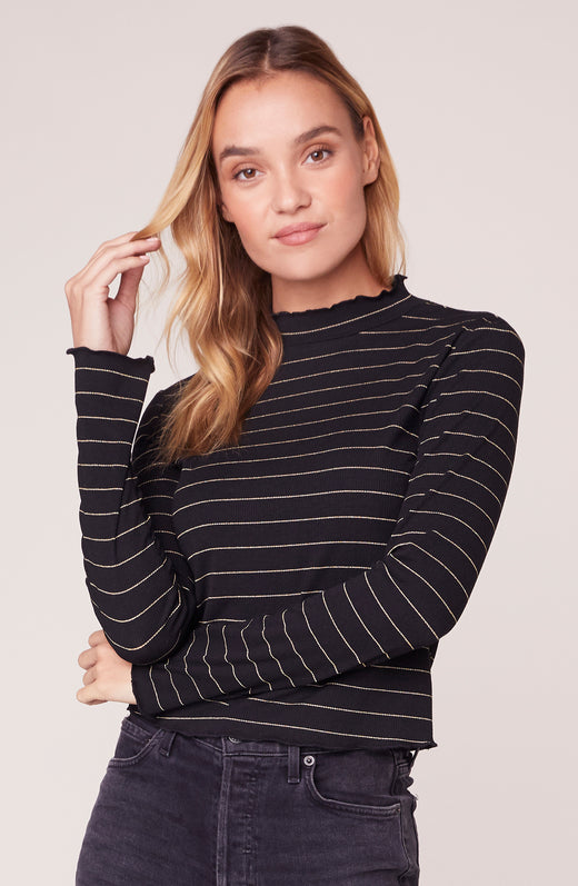 Model wearing striped turtleneck
