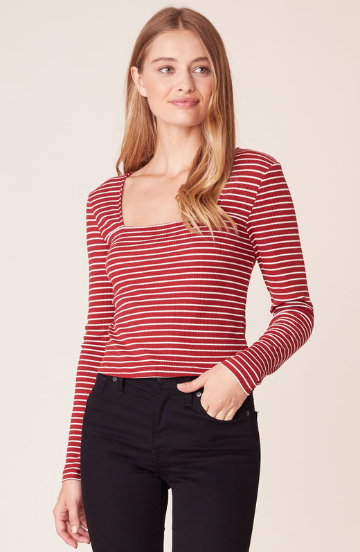 Front view of model wearing striped long sleeve top