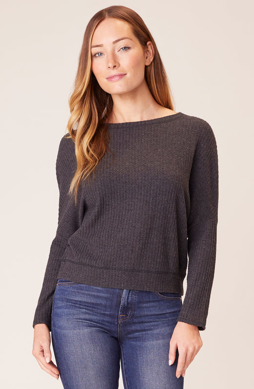 Front view of model wearing waffle knit top in grey