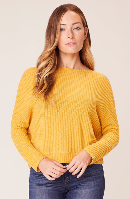 Front view of model wearing waffle knit top in yellow