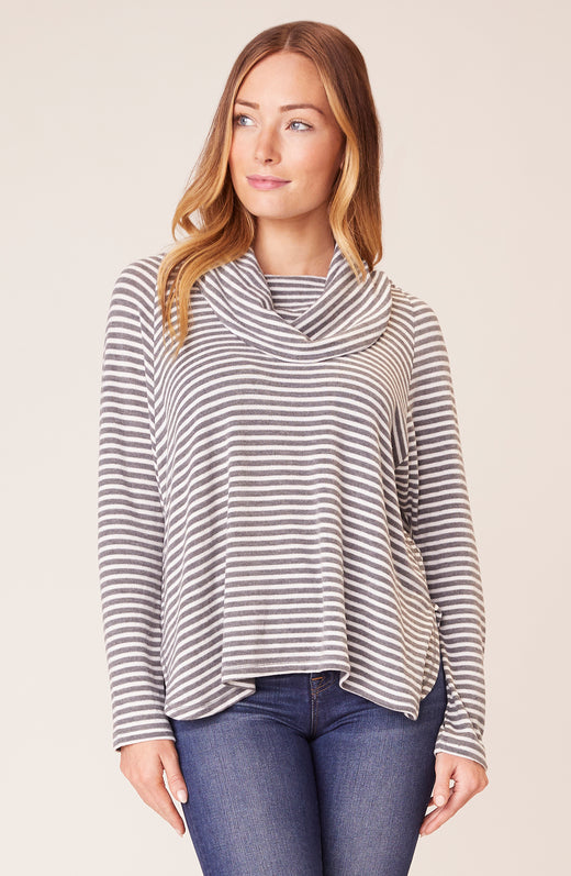 Front view of model wearing striped cowl neck top