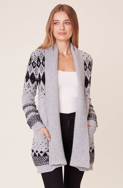 Front view of model wearing fairisle cardigan sweater