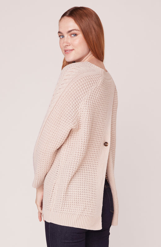 Back view of model wearing waffle knit sweater