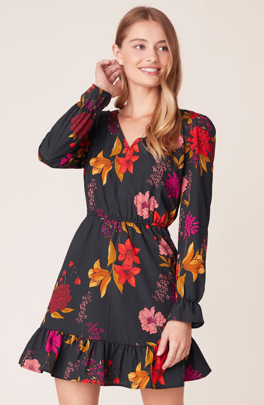 Front view of model wearing floral long sleeve dress