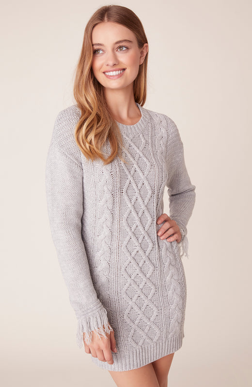 Front view of model wearing cable knit dress