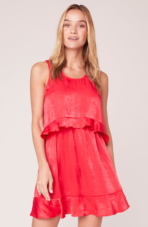 Model wearing sleeveless red dress