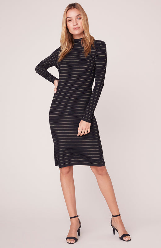 Model wearing mock neck long sleeve striped dress