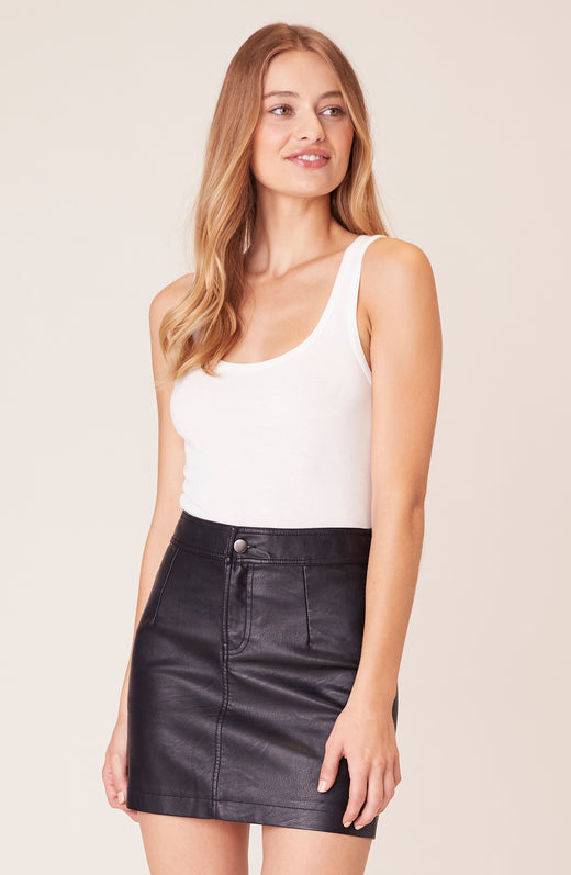 Front view of model wearing vegan leather skirt