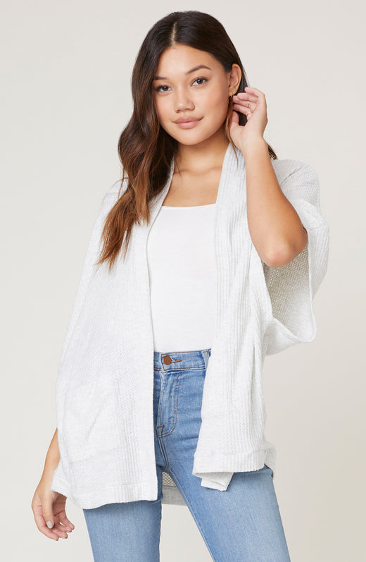 Model wearing dolman sleeve cardigan