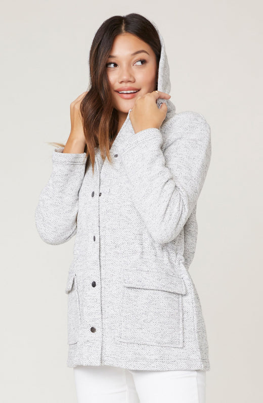 Model wearing sweater knit anorak
