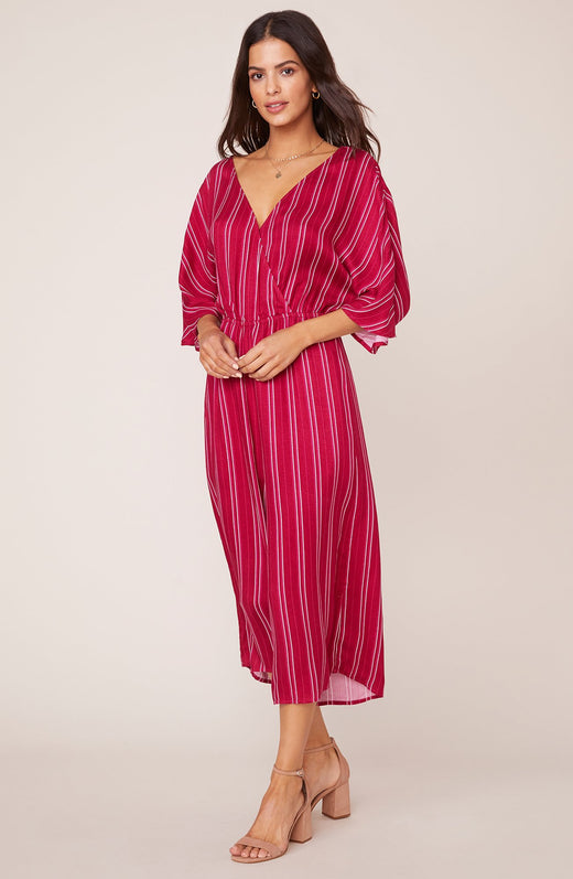 Model wearing red pinstripe jumpsuit