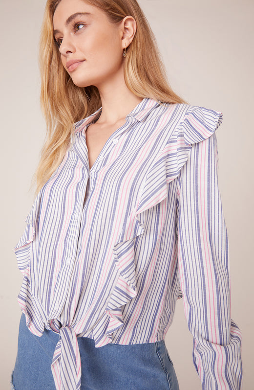 Model wearing striped and ruffled shirt