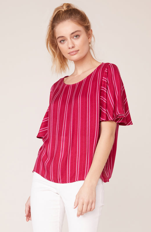 Model wearing red pinstriped top