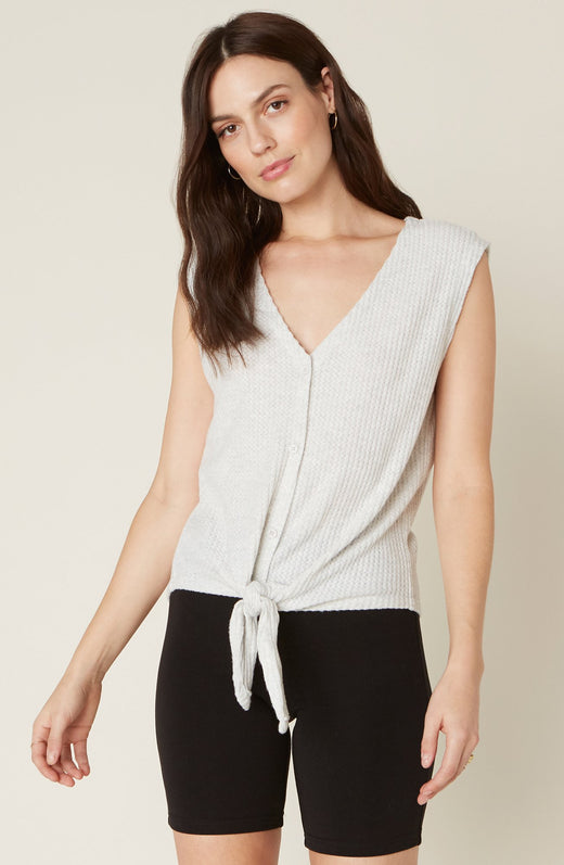 Model wearing light grey waffle knit tank top