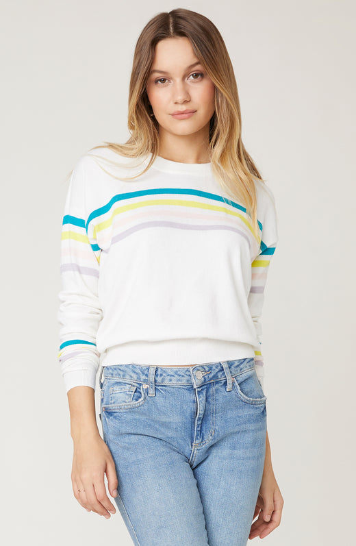 Model wearing striped long sleeve sweater