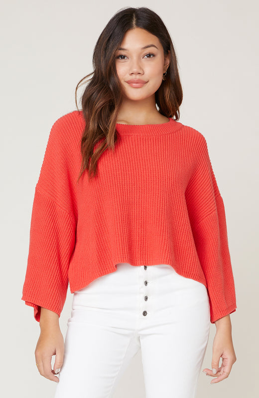 Model wearing oversized cropped sweater