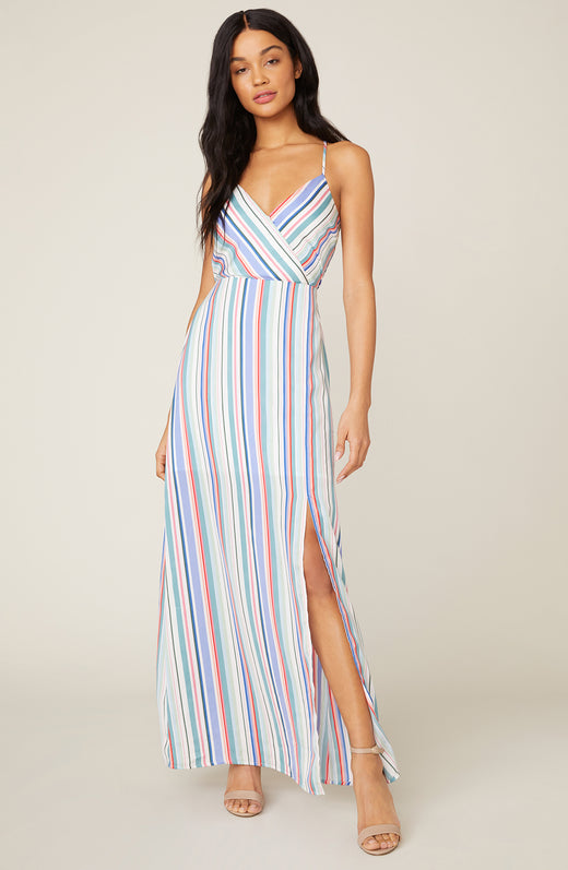 Model wearing vertical striped maxi dress