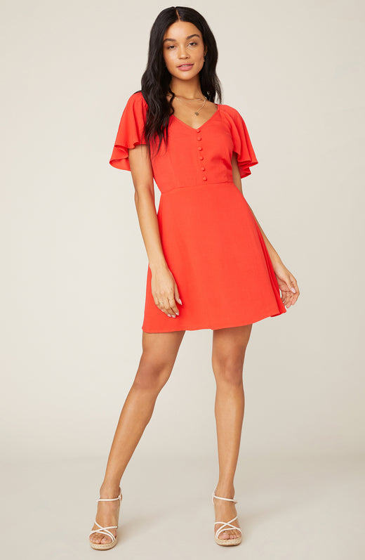 Model wearing coral a-line mini dress