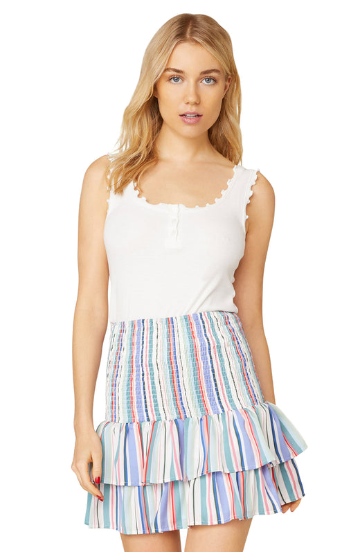Model wearing smocked mini skirt with vertical stripes