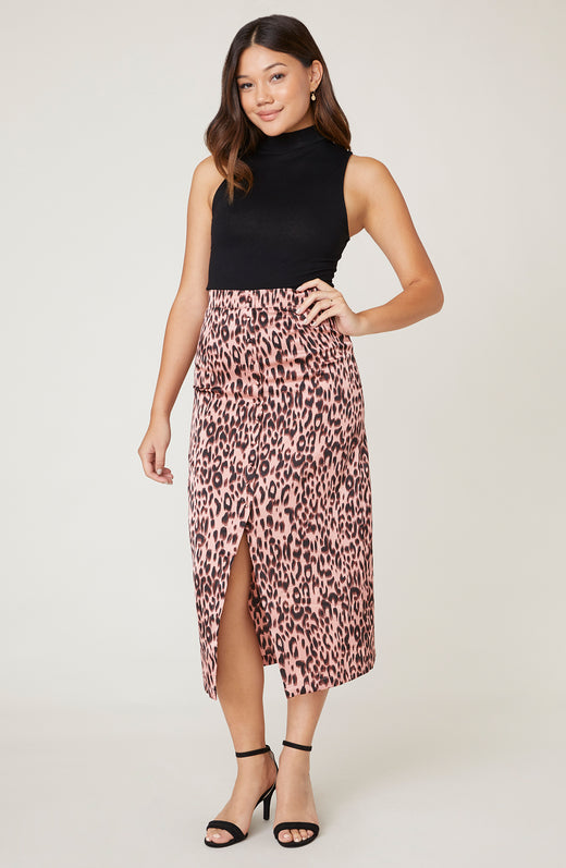 Model wearing pink leopard midi skirt