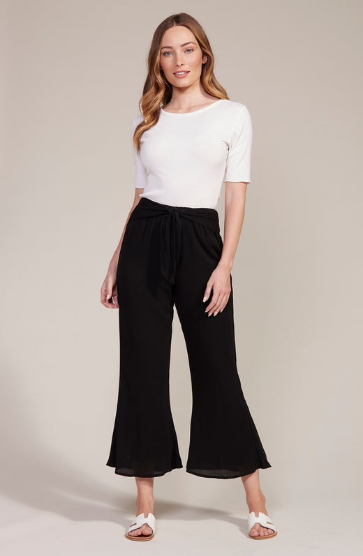 Model wearing black cropped flare pants