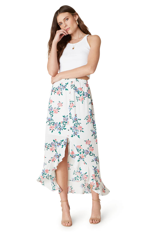 Model wearing allover floral high low midi skirt