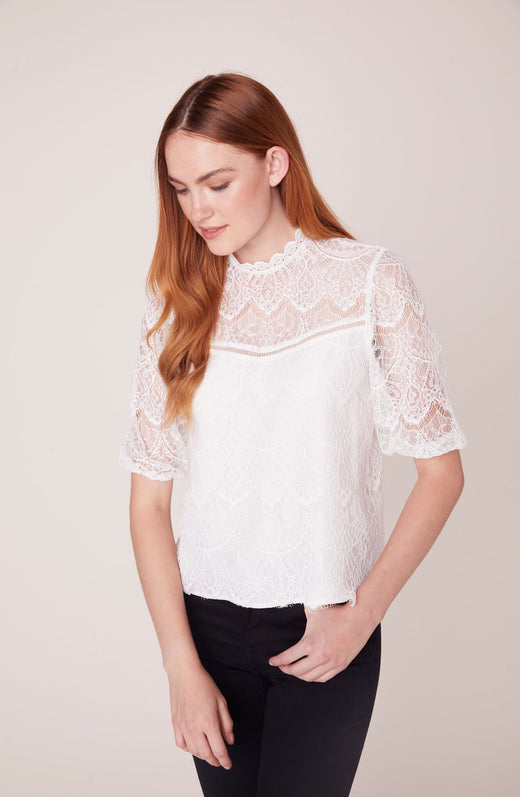 Model wearing ivory lace top