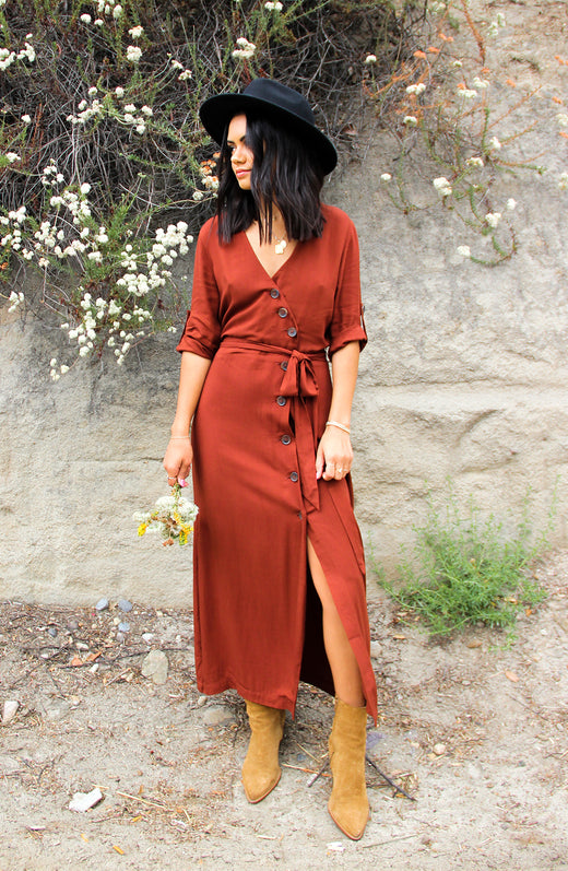 Blogger wearing midi length burnt orange dress