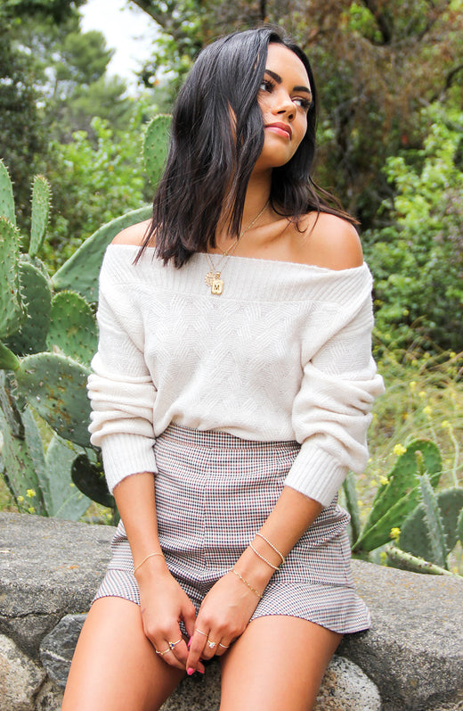 Blogger wearing off the shoulder ivory sweater