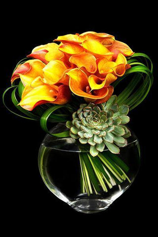 Arrangement of Calla Lilies in a fish-eyed shape vase.
