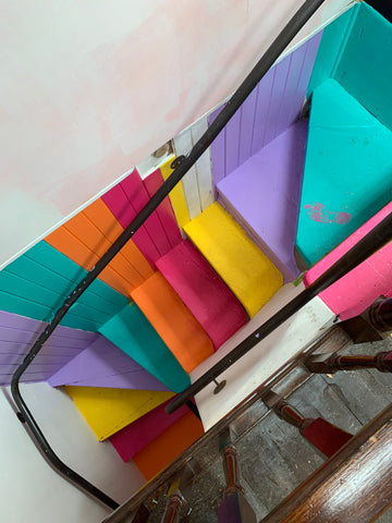 A top-down shot of our signature rainbow stairs, lovingly painted by our in-store team. Just don't mention the boot print on the top step, ya hear? We reckon it adds character!