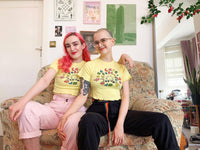 Lucy & Yak Tops 'Greta' Lettuce Edge Tee in Pale Yellow With Take Care Print by Wednesday Holmes