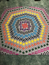63x63 Frisson Quilt from Jack Squares Studio grey background with brights