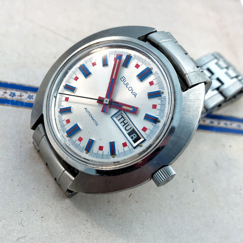 FAR-OUT~1972 BULOVA JET STAR DAY/DATE RED/BLUE.