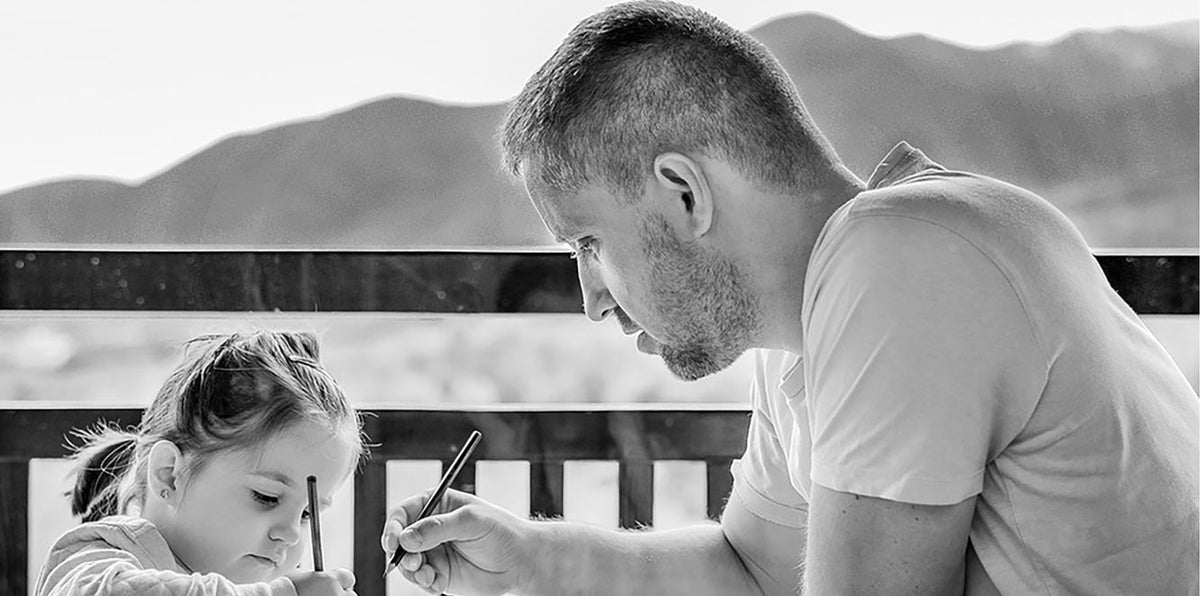 Father coloring with daughter
