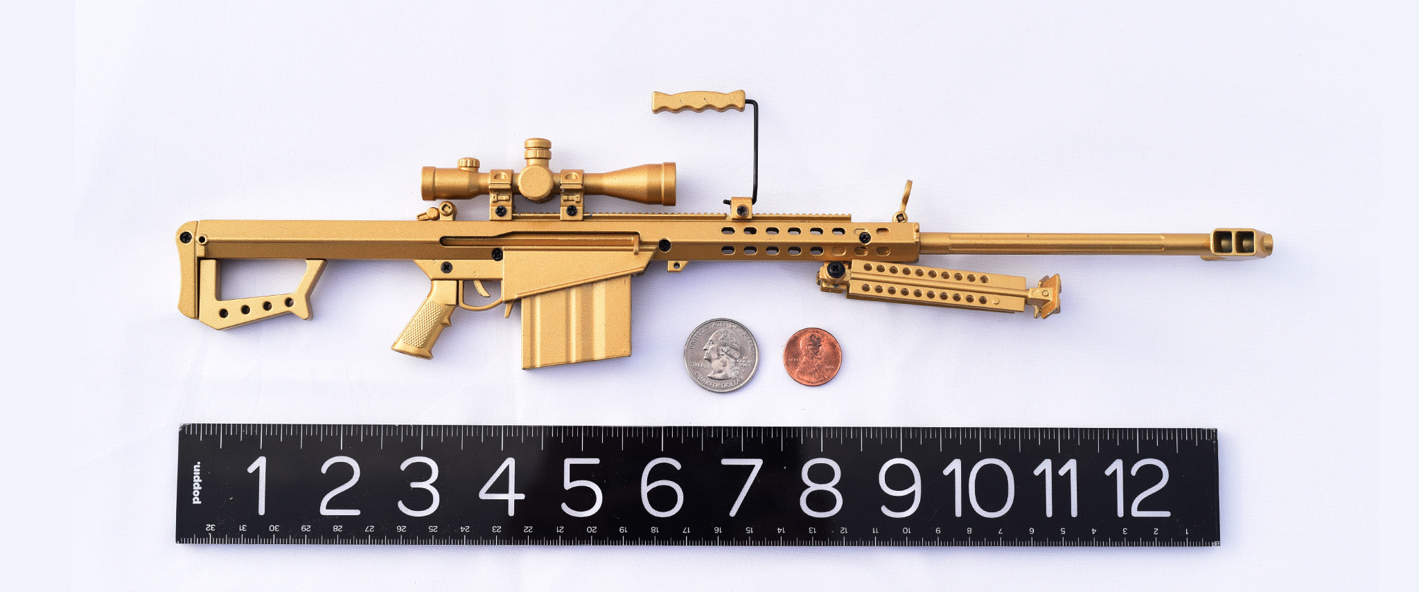 "Mini .50 Cal (gold) against 12"" ruler"