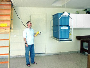 guy with corded versalift attic lift